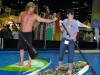 girard-middleton-teaching-sup-in-the-demo-pool-at-orlando-surf-expo-jan-2011